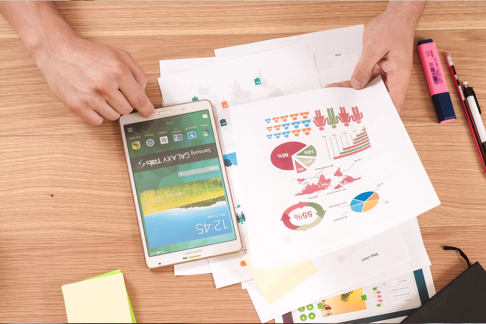 Comparing information from infographs beside large phone or small tablet